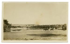 [Photograph of Two Men on Horses Near Rio Grande River]