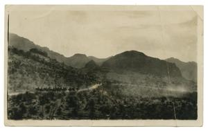 [Photograph of Soldiers Riding through the Mountains]