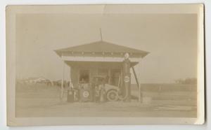 [Photograph of a Car at Hanes Filling Station]