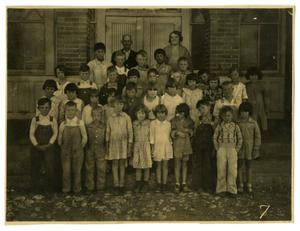[Photograph of Elementary Students by a School]