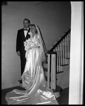 Primary view of object titled 'Wallace Scott Jr. Wedding - Bride and Groom pose on stairway'.