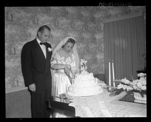 Primary view of object titled 'Wallace Scott Jr. Wedding - Bride and Groom cut the cake'.