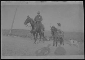 Primary view of object titled '[Postcard image of a man on horseback and a  child on a pony]'.