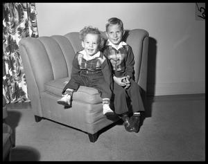 [Two Small Boys on Chair]