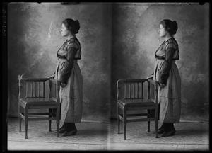 Primary view of object titled '[Woman Standing With Chair]'.