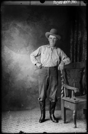 Primary view of object titled '[Portrait of Man in Hat and Boots Standing]'.