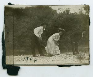 Primary view of object titled '[Photograph of Three Individuals at Rowlett Creek]'.