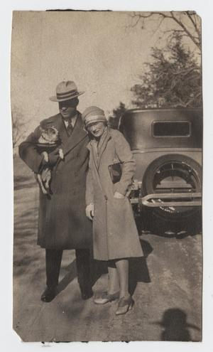 Primary view of object titled '[Photograph of a Couple with a Dog]'.