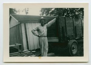 Primary view of object titled '[Photograph of Oscar D. Back and a Trailor]'.