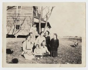 Primary view of object titled '[Photograph of Eight Individuals at the Turley Home]'.