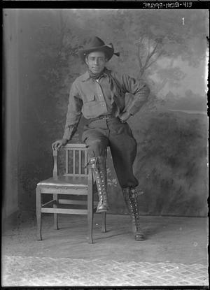 Primary view of object titled '[Portrait of Man with Chair]'.