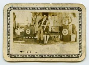 Primary view of object titled '[Photograph of a Unknown Couple at a Gas Pump]'.