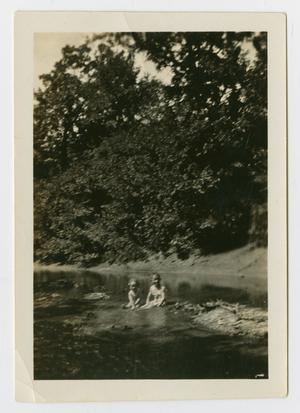 Primary view of object titled '[Photograph of Marie and Darmond Matlock in Rowlett Creek]'.