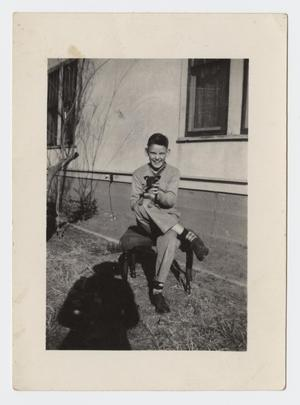 Primary view of object titled '[Photograph of Jimmy Arnold with his Dog]'.