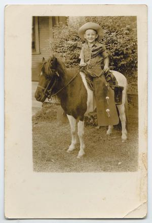 Primary view of object titled '[Photograph of an Unknown Boy on a Pony]'.
