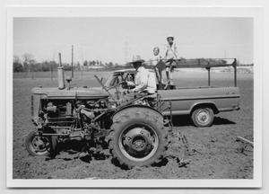 Primary view of object titled '[Photograph of Oscar D. Back on a Tractor]'.