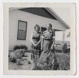 Primary view of object titled '[Photograph of Two Unknown Women by a House]'.