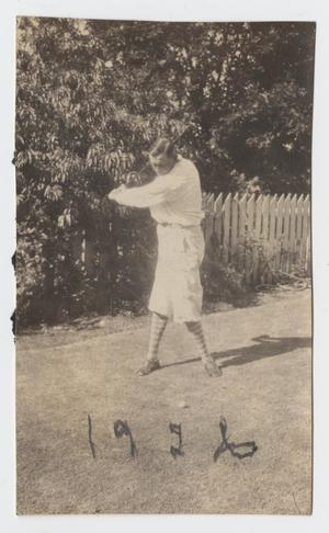 Primary view of object titled '[Photograph of Lee Turney Swinging a Golf Club]'.