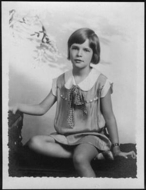 Primary view of object titled '[Photograph of Mary Jones sitting on an upholstered bench]'.