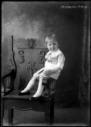 Primary view of object titled '[Portrait of Child in Chair]'.