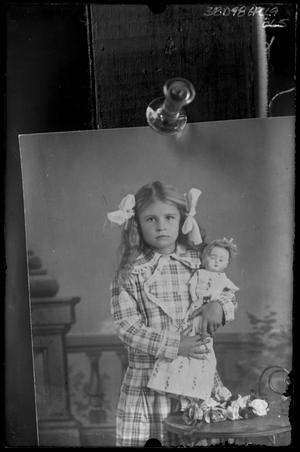 Primary view of object titled '[Picture of Girl with Doll]'.