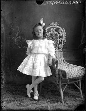 Primary view of object titled '[Portraits of Girl Beside Chair]'.