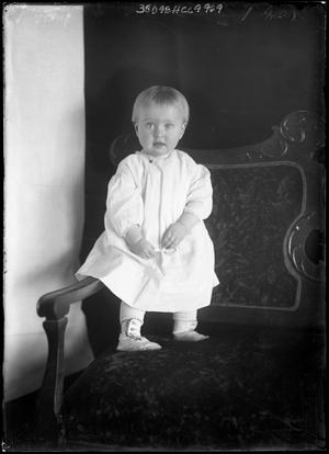 Primary view of object titled '[Portrait of Baby Standing in Chair]'.