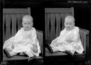 Primary view of object titled '[Portraits of Child Sitting in Chair]'.