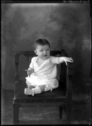 Primary view of object titled '[Portrait of Baby Sitting in Chair]'.