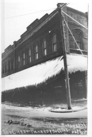 Primary view of object titled '[Brick two story building with iced-over awning]'.