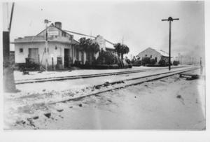 Primary view of object titled '[Rosenberg Depot covered in snow]'.