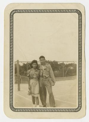 [Photograph of Man and Woman Posing at Tennis Courts]