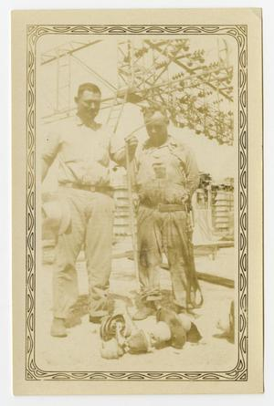 Primary view of object titled '[Two Men Standing by Electric Station]'.