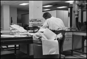 Primary view of object titled '[Man Working at Desk at Beaumont Enterprise #3]'.