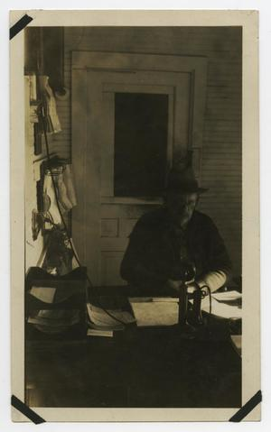 Primary view of object titled '[Old Man Sitting at Desk]'.