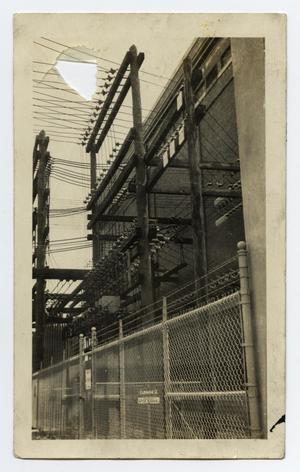 Primary view of object titled '[Gate, Power Lines, and Building]'.