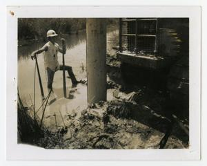 Primary view of object titled '[Man Wearing Hard Hat Standing In Water]'.
