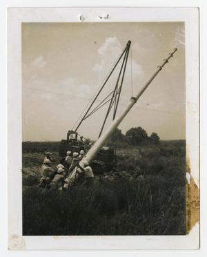 Primary view of object titled '[Group of Men Lifting Long Pole]'.