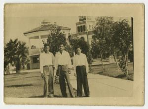 [Photograph of Three Men Posing Outside]