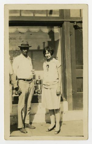 Primary view of object titled '[Man and Woman in Front of Shop Window]'.