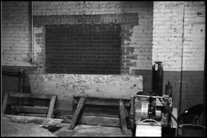 Primary view of object titled '[Brick Wall at Beaumont Enterprises]'.