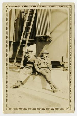 Primary view of object titled '[Two Men Sitting by Ladder]'.