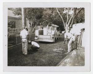 Primary view of object titled '[Four Construction Men in Backyard]'.