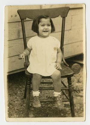 [Photograph of Elvira Martinez Sitting on Chair]