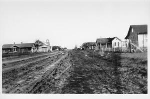 Primary view of object titled '[A dirt road in residential Rosenberg]'.