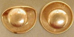 "Primary view of object titled '[A pair of gold button cuff links underneath states: ""KREMENTZ PLATE""]'."