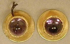 Primary view of object titled '[A pair of gold cuff links with amethyst stone inlaid in the center]'.