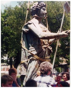 Bee County Courthouse's Lady Justice Lowered for Repairs, 2001