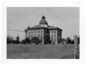 Primary view of object titled 'Bee County Courthouse: Early View from the Houston Highway'.