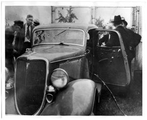 Primary view of object titled '[Clyde Barrow and Bonnie Parker's Bullet Hole-Ridden V8 Ford]'.
